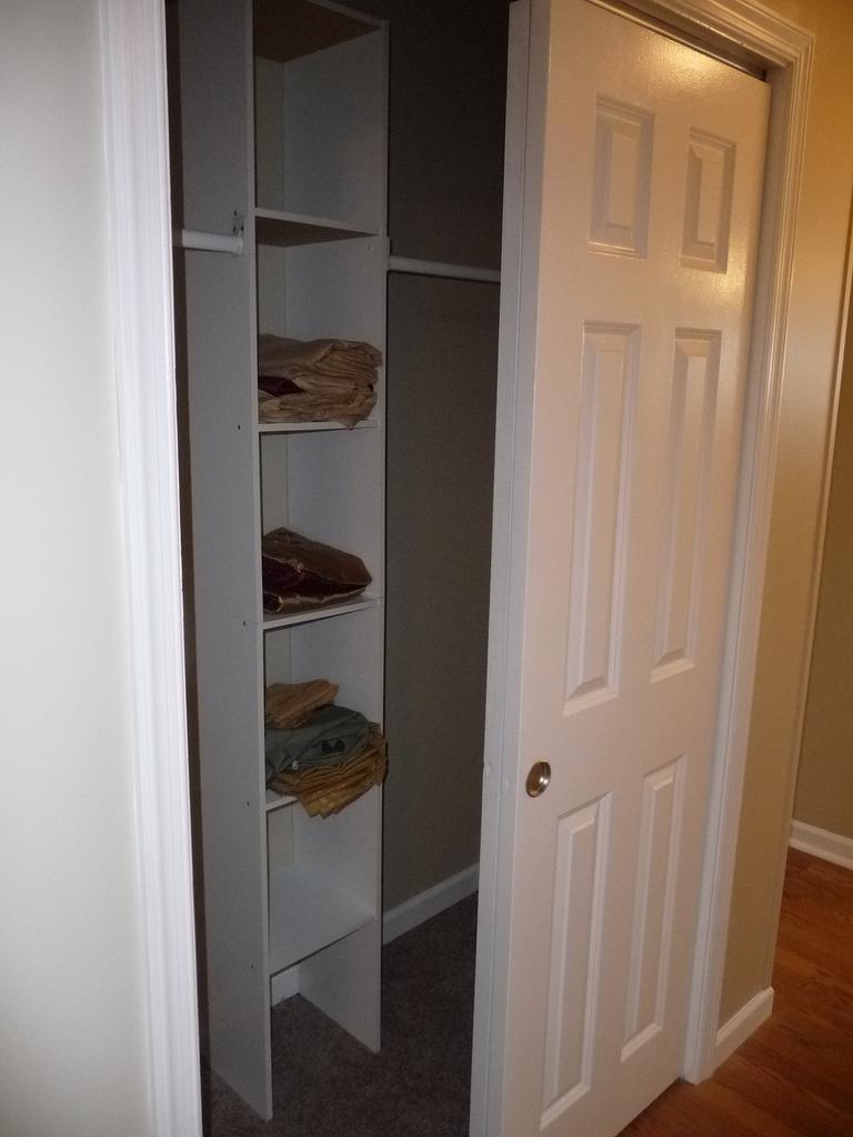 Linen & Coat Closet in hall